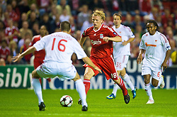 LIVERPOOL, ENGLAND - Wednesday, September 16, 2009: Liverpool's Dirk Kuyt and Debreceni's Adam Komlosi during the UEFA Champions League Group E match at Anfield. (Photo by David Rawcliffe/Propaganda)
