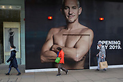 The ex-England footballer, now BBC TV football presenter Gary Lineker appears large on a construction hoarding in Oxford Street, on 5th March 2019, in London, England.