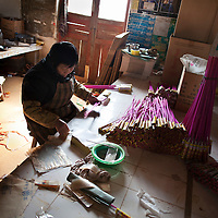 Hunan, Liuyang, Dec. 19..2013 : Li Guangmei, a worker, assembles  fireckrackers for the Western market in a factory .