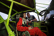 Race car driver Bryce Leifheit from Verdigris discusses strategy with his father prior to his upcoming race at Salina High Banks Speedway.