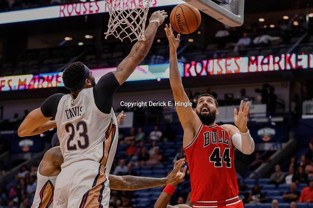 Oct 3, 2017; New Orleans, LA, USA; New Orleans Pelicans forward Anthony Davis (23) blocks a shot by Chicago Bulls forward Nikola Mirotic (44) during the second quarter of a NBA preseason game at the Smoothie King Center. Mandatory Credit: Derick E. Hingle-USA TODAY Sports