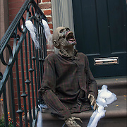 Halloween decoration on steps of brownstone in Greenwich Village, NYC.