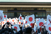 Well-wishers wave a Japanese national flag as Japan's Emperor Akihito appears on a balcony of the Imperial Palace during a public appearance for New Year celebrations at the Imperial Palace in Tokyo, Japan, January 2, 2018. 02/01/2018-Tokyo, JAPAN