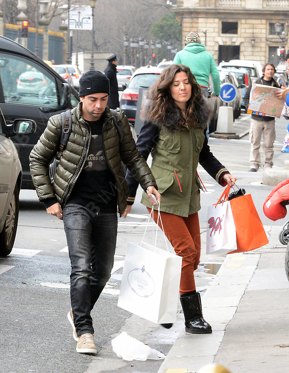 11.FEBRUARY.2013. PARIS<br /> <br /> XAVI HERNANDEZ AND HIS GIRLFRIEND NURIA CUNILLERA SPOTTED SHOPPING AROUND PARIS<br /> <br /> BYLINE: EDBIMAGEARCHIVE.CO.UK<br /> <br /> *THIS IMAGE IS STRICTLY FOR UK NEWSPAPERS AND MAGAZINES ONLY*<br /> *FOR WORLD WIDE SALES AND WEB USE PLEASE CONTACT EDBIMAGEARCHIVE - 0208 954 5968*