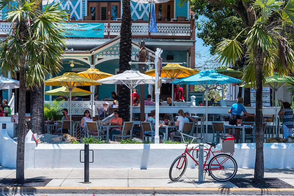 Key West, Florida--April 29, 2018. Patrons enjoy outdoor dining along Duval Street in Key West. Editorial Use Only.