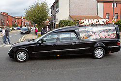 © Licensed to London News Pictures.  14/09/2012. LONDON, UK. The cortege containing the body of murdered school girl Tia Sharp enters Garth Road Crematorium in Morden. The route of the cortege was lined with pink balloons and some mourners wore pink tops. Photo credit :  Cliff Hide/LNP