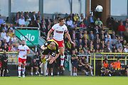 Rotherham United defender Richard Wood (6) heads clear under pressure from Burton Albion forward Liam Boyce (27) during the EFL Sky Bet League 1 match between Burton Albion and Rotherham United at the Pirelli Stadium, Burton upon Trent, England on 17 August 2019.