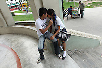 A young couple spends time together in a plaza in Matamoros, Mexico on April 23, 2010. Matamoros has long been controlled by drug cartels and of late the city has been besieged by violence between cartels vying for control of the lucrative drug trade. (Photo/Scott Dalton)