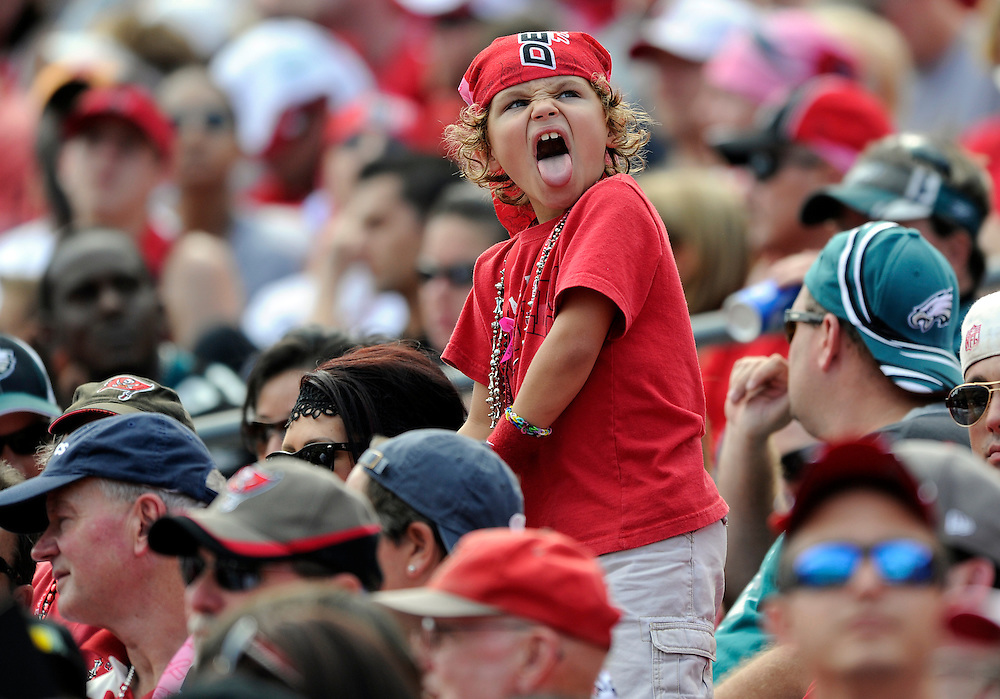 A young Buccaneers' fan sticks his tongue out as the Bucs face the Eagles in the second half Sunday, Oct. 13, 2013 in Tampa. The Buccaneers lost 31-20. CHRIS URSO/STAFF