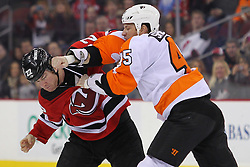 Jan 21; Newark, NJ, USA; New Jersey Devils left wing Eric Boulton (22) and Philadelphia Flyers left wing Jody Shelley (45) fight during the first period at the Prudential Center.