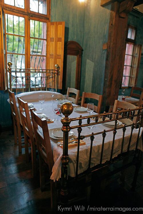 South America, Chile, Santiago. Como Agua para Chocolate restuarant bed table setting.