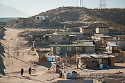 People walk around the slums of Anarba, one of the poorest slums of Juarez, where a ready supply of gang members fuel the ongoing drug war in  Mexico January 15, 2009. The drug war has already claimed more than 40 people since the start of the year. More than 1600 people were killed in Juarez in 2008, making Juarez the most violent city in Mexico.    (Photo by Richard Ellis)