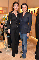 Left to right, FRANCESCA BELLUCCI and ALLEGRA DONN at a breakfast at Roger Vivier, 188 Sloane Street to view the SS2014 Roger Vivier collections held on 20th March 2014.