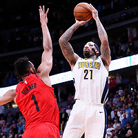 09 April 2018: Denver Nuggets forward Wilson Chandler (21) takes a jump shot over Portland Trail Blazers forward Evan Turner (1) during the Denver Nuggets 88-82 victory over the Portland Trail Blazers, at the Pepsi Center, Denver, Colorado, USA.