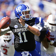 UK quarterback Maxwell Smith looked downfield for a receiver in the second quarter as the University of Kentucky plays the University of Louisville at Commonwealth Stadium in Lexington, Ky. Saturday Sept. 14, 2013. Photo by David Stephenson