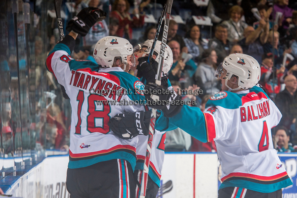KELOWNA, CANADA - MARCH 24: Carsen Twarynski #18 and Gordie Ballhorn #4 of the Kelowna Rockets celebrate a goal against the Kamloops Blazers on March 24, 2017 at Prospera Place in Kelowna, British Columbia, Canada.  (Photo by Marissa Baecker/Shoot the Breeze)  *** Local Caption ***