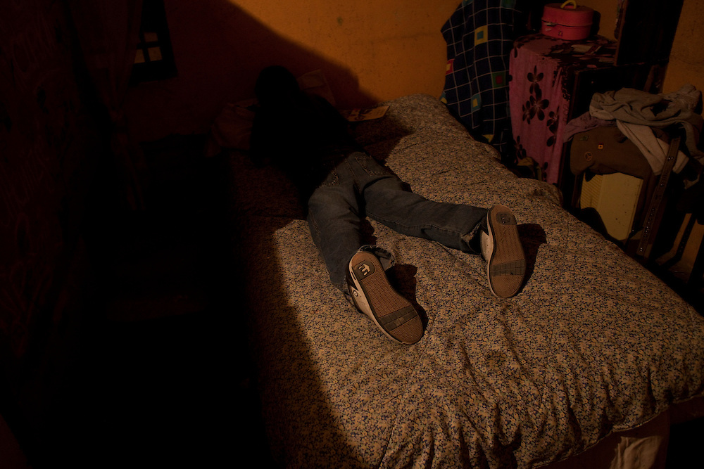 Pedro Ivan, 12, buries his face in a pillow in the Diaz Ordaz colonia in Ciudad Juarez, Chihuahua Mexico on May 1, 2010.