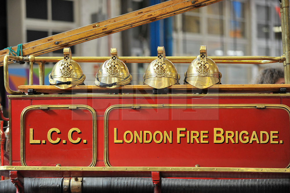 © Licensed to London News Pictures. 09/09/2017. London, UK. Helmets sit atop a Dennis N-Type 1916 fire engine at London Fire Brigade's annual Fire Engine Festival in Lambeth.  The earliest motorised fire engines still working, London Fire Brigade's brand new pump as well as firefighter uniforms are on display. Photo credit : Stephen Chung/LNP