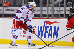 Sep 16, 2013; Newark, NJ, USA; New York Rangers left wing Rick Nash (61) skates with the puck during the first period of their game against the New Jersey Devils at Prudential Center.