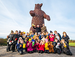 Dunbar, East Lothian, Scotland, United Kingdom, 19 November 2019. Andy Scott statue unveiling: Unveiling today of a 5m high bear sculpture to celebrate the life of naturalist John Muir. The sculpture by the Kelpies creator Andy Scott marks Dunbar-born John Muir who played a key role in the development of national parks in the US. Pictured: Ken Ross (Hallhill Developments), Andy Scott (sculptor) and children from Primary 4 at Dunbar Primary School.<br /> Sally Anderson | EdinburghElitemedia.co.uk
