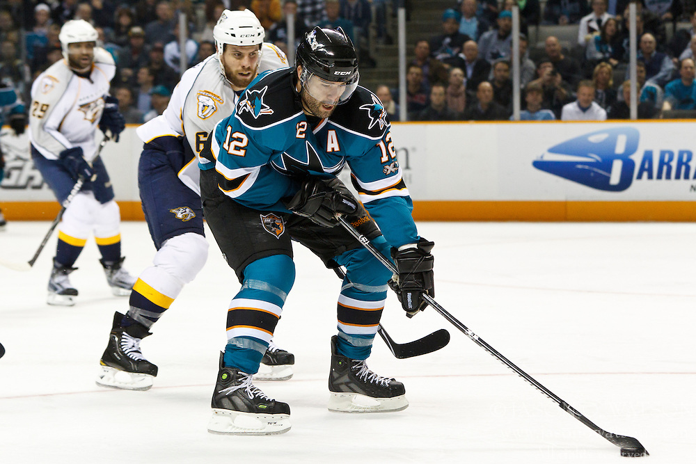 March 8, 2011; San Jose, CA, USA;  San Jose Sharks center Patrick Marleau (12) is defended by Nashville Predators defenseman Shea Weber (6) during the third period at HP Pavilion. San Jose defeated Nashville 3-2 in overtime. Mandatory Credit: Jason O. Watson / US PRESSWIRE