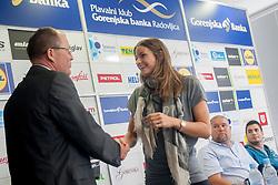 Ales Klement, president of swimming club Gorenjska banka Radovljica and Sara Isakovic at Press conference of Sara Isakovic when she retires on August 14, 2014 in Radovljica, Slovenia. Photo by Urban Urbanc / Sportida