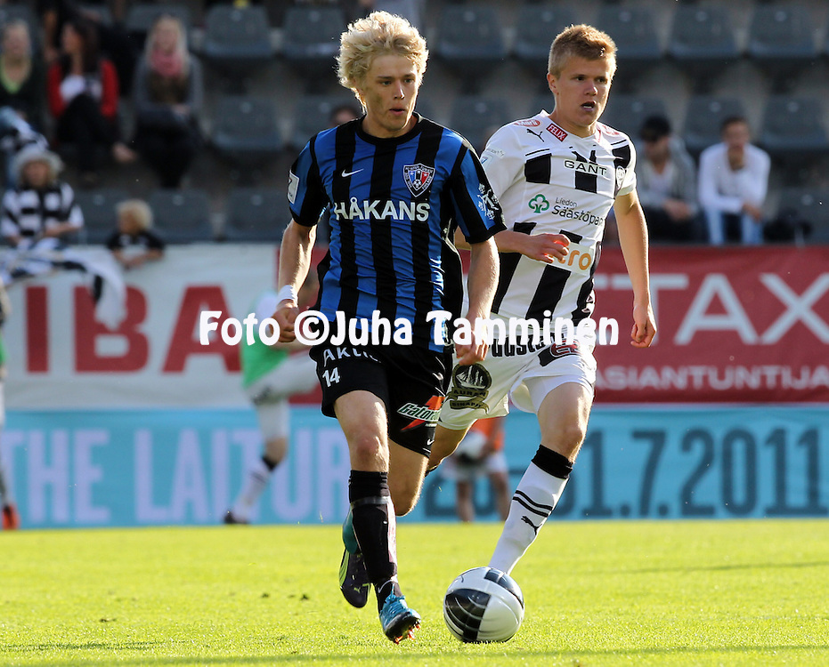 16.6.2011, Veritas stadion, Kupittaa, Turku..Veikkausliiga 2011, FC TPS Turku - FC Inter Turku..Joni Aho (Inter) v Petteri Pennanen (TPS)..