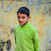 This boy was the son of our tour guide Saleh in the desert of Wadi Rum Jordan. They are very friendly kids.