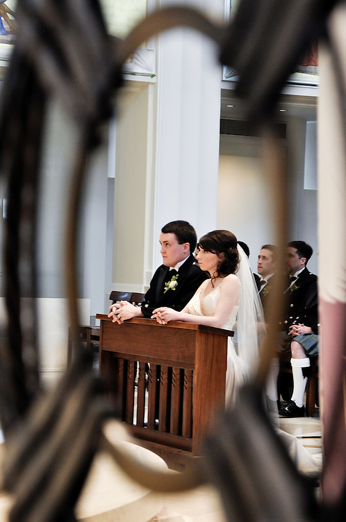 Kathleen & Brendan kneel before the altar, Madonna della Strada Chapel, Loyola University Chicago