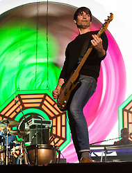 © Licensed to London News Pictures. 13/06/2015. Isle of Wight, UK.   Blur performing live at Isle of Wight Festival 2015, Day 3 Saturday,headlining the main stage.  In this picture - Alex James.   Headline acts include The Prodigy, Blur and Fleetwood Mac.   Photo credit : Richard Isaac/LNP