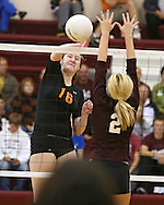 Solon's Jordan Runge (16) goes for a kill around the hands of Mount Vernon's Chelsey Schirm (2) during the WaMaC Tournament semifinal game at Mount Vernon High School in Mount Vernon on Thursday October 11, 2012. Solon defeated Mount Vernon 26-24, 25-22.