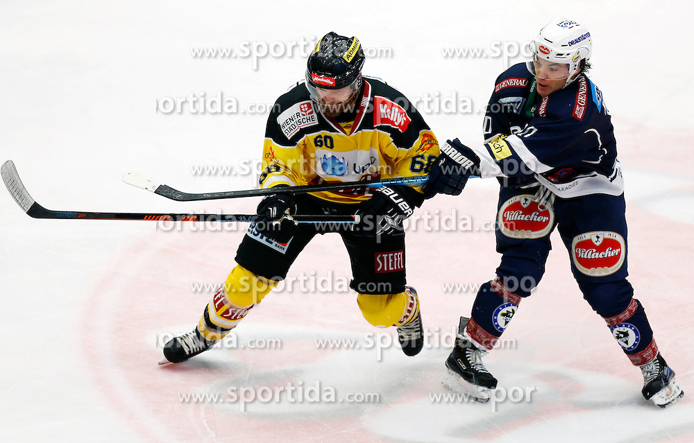 17.11.2015, Stadthalle, Villach, AUT, EBEL, EC VSV vs UPC Vienna Capitals, 21. Runde, im Bild Troy Milam (Capitals) und Brock McBride (VSV) // during the Erste Bank Icehockey League 21th round match between EC VSV vs UPC Vienna Capitals at the City Hall in Villach, Austria on 2015/11/17, EXPA Pictures © 2015, PhotoCredit: EXPA/ Oskar Hoeher
