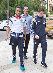 HAIFA, ISRAEL - Saturday, March 28, 2015: Wales' Neil Taylor and Joe Allen with Israel security on a team walk ahead of the UEFA Euro 2016 qualifying Group B match against Israel. (Pic by David Rawcliffe/Propaganda)