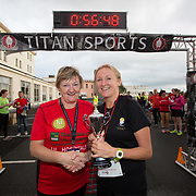 25.08. 2017.                                                      <br /> Almost 200 UL Hospitals Group staff, past and present, and members of the public completed the annual 5k Charity Run/Walk on Friday August 25th in Limerick.<br /> <br /> Kathy Sheehan, Assistant Director of Nursing, Perioperative Directorate presents the trophy for 1st  female staff member home to Helen Hartigan, Croom.<br /> <br /> <br /> Everybody who participated also raised funds for Friends of Ghana, an NGO formed last year by UL Hospitals Group and its academic partner the University of Limerick to deliver medical training programmes in the remote Upper West Region of Ghana. Picture: Alan Place