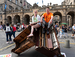 Edinburgh, Scotland, UK. 2 August 2019. On the opening day of the Edinburgh Festival Fringe three piano were made into a sculpture to promote #Pianodrome a venue made from unicycle pianos.