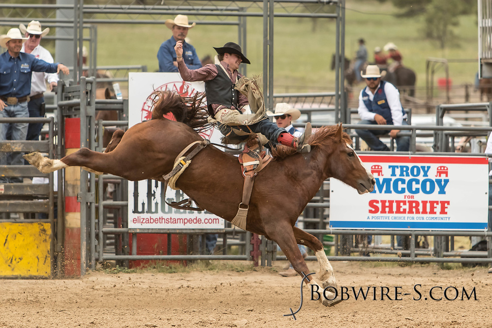 Bareback rider Brent Bannon rides Summit Pro Rodeo's Big Iron during the third performance of the Elizabeth Stampede on Sunday, June 3, 2018.