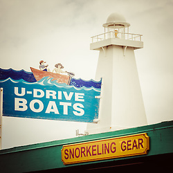 U-Drive Boats sign and lighthouse on Catalina Island Avalon California. Catalina Island is a popular travel destination off the coast of Southern California in the United States.