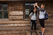 Tourist explore the City Slickers Cabin, which sits at the entrance to New Mexico's Historic Ghost Ranch.