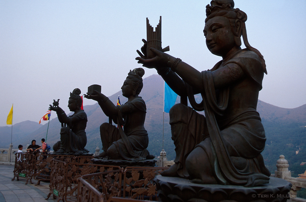 Bodhisattva statues offer gifts to the Tian Tau Buddha statue at the Po Lin Monastery on Lantau Island, Hong Kong, China.