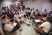 Daily 8:00 AM team meeting. Burton Richter bottom left of image. Burton Richter (b.1931), Director of the Stanford Linear Accelerator Center (SLAC), photographed during the construction of the Stanford Linear Collider in [1988] Richter won the 1976 Nobel Prize for Physics, following his discovery of the Psi- particle at the SLAC in 1974. The Prize was shared with Sam Ting of Brookhaven National Laboratory. The discovery of the Psi- particle also implied the existence of two new quarks, Charm and anti- Charm. Richter has been at SLAC since 1964, having also designed the PEP positron-electron storage ring at Stanford. Richter became Director of SLAC in 1984, and now oversees projects such as the Stanford Linear Positron-Electron Collider. [1988]