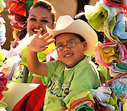Participants wave to the crowds at the Tucson Rodeo Parade, the longest non-motorized parade in the nation. This 89-year-old event occurs each February in conjunction with La Fiesta de los Vaqueros, the Tucson Rodeo.  The event draws over 150,000 spectators in southern Tucson.