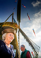14-10-2017 ROELOFARENDSVEEN - Prinses Beatrix der Nederlanden verricht zaterdagochtend 14 oktober de heringebruikstelling van de Googermolen in Roelofarendsveen.<br /> De afgelopen maanden heeft de molen stilgestaan vanwege groot onderhoud. De Googermolen bestaat dit jaar 300 jaar en is een van de grootste poldermolens in Nederland. De roeden waar de wieken aan vast zitten hebben een lengte van bijna 29 meter en de molenkap weegt 23 ton. Vrijwillige molenaars houden de Googermolen in bedrijf. De molen fungeert als hulpgemaal van het Hoogheemraadschap van Rijnland voor de Googerpolder en wordt ingezet bij extreme wateroverlast of als het gemaal niet werkt.Copyright Robin Utrecht<br /> <br /> 14-10-2017 ROELOFARENDSVEEN - Princess Beatrix of the Netherlands performs the recycling of Googermolen in Roelofarendsveen on Saturday 14 October.<br /> In recent months the mill has stood still due to major maintenance. The Googermolen is 300 years old and is one of the largest polder mills in the Netherlands. The rows on which the wicks are stuck has a length of almost 29 meters and the mill cover weighs 23 tons. Volunteer millers are in charge of the Googermolen. The mill acts as auxiliary board of the Hoogheemraadschap van Rijnland for the Googerpolder and is used in extreme waterfalls or if the ground is not working.Copyright Robin Utrecht