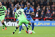 Tom Elliott of AFC Wimbledon battles with Rob Sinclair during the The FA Cup match between AFC Wimbledon and Forest Green Rovers at the Cherry Red Records Stadium, Kingston, England on 7 November 2015. Photo by Stuart Butcher.