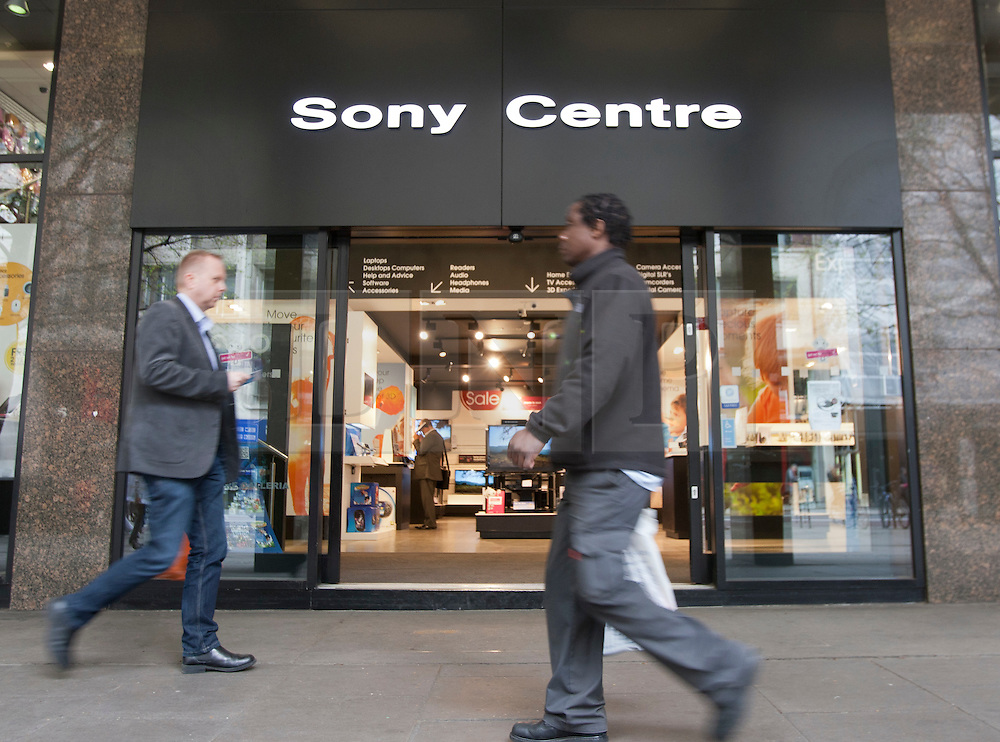 © licensed to London News Pictures. London, UK 12/04/2012. People walking past a Sony Centre on Tottenham Court Road. Sony was reported to be looking to shed 10,000 jobs worldwide this year as the company losses £4.2bn this year. Photo credit: Tolga Akmen/LNP