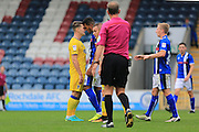 Jake Reeves, Nathaniel Mendez-Laing head to head during the EFL Sky Bet League 1 match between Rochdale and AFC Wimbledon at Spotland, Rochdale, England on 27 August 2016. Photo by Daniel Youngs.
