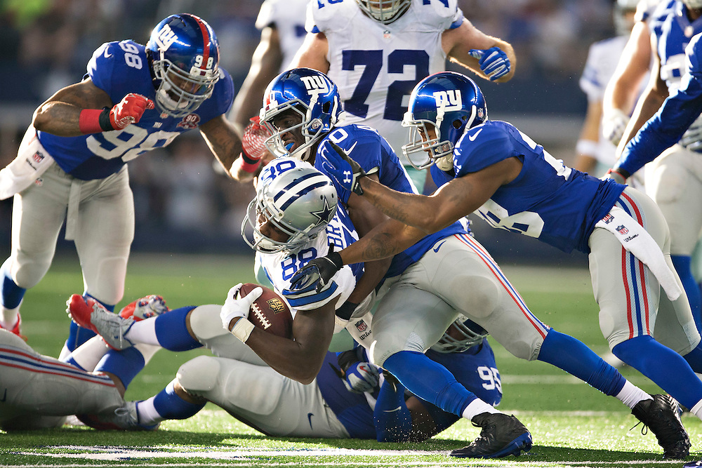 ARLINGTON, TX - OCTOBER 19:  Dez Bryant #88 of the Dallas Cowboys is tackled by Prince Amukamara #20 of the New York Giants at AT&T Stadium on October 19, 2014 in Arlington, Texas.  The Cowboys defeated the Giants 31-21.  (Photo by Wesley Hitt/Getty Images) *** Local Caption *** Dez Bryant; Prince Amukamara