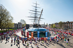 © Licensed to London News Pictures. 22/04/2018. London, UK. Marathon runners pass the Cutty Sark in Greenwich as they run the Virgin Money London Marathon 2018. Photo credit: Rob Pinney/LNP