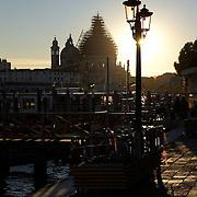 Italy, Veneto, Venice. November/12/2007...Basilica della Salute as seen from Piazza San Marco at sunset in Venice, Italy. .