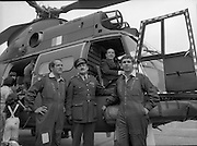 "Air Corps Takes Delivery Of Puma Helicoptor. (N86)..1981..22.07.1981..07.22.1981..22nd July 1981..The Air Corps took delivery,today, of a new French Built SA 330 J ""Puma"" Helicoptor. The ""Puma"" escorted by another Air Corps helicoptor landed at Casement Aerodrome, Baldonnell,Co Dublin...The Minister for Defence, James Tully TD, takes over the command seat of the helicoptor while Comdt. Hugh O'Donnell and Comdt Ken Byrne (the pilots) stand by. Brig-General William Glenn, GOC,Air Corps oversees.In the background crew members family climb aboard to explore."