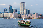 Star Ferry crossing Victoria Harbour toward Kowloon Hong Kong.